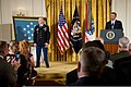 President Barack Obama delivers remarks during a ceremony to present a Medal of Honor to U.S. Army Staff Sgt. Ty Michael Carter, on podium, left, at the White House in Washington, D.C., Aug. 26, 2013 130826-A-VS818-493.jpg