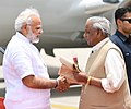 Prime Minister Narendra Modi being welcomed by the Governor of Rajasthan Kalyan Singh.jpg
