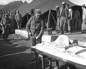 "United States Marine Corps birthday - Col Lewis B. ""Chesty"" Puller cuts the Marine Corps birthday cake in 1950, during a brief reprieve in battle during the Korean War."