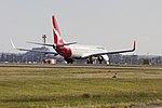 Qantas (ZK-ZQC) Boeing 737-838(WL) taking off on runway 25 at Sydney Airport.jpg
