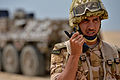 Qatar Armed Forces 1st Lt. Abdul Majid Al-Shammari, a special operations forces officer, communicates with other members of his unit during a joint counterterrorism exercise with U.S. Service members and other 130428-F-CJ989-007.jpg