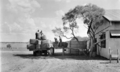 Queensland State Archives 5272 Loading the wool Strathdarr Station c 1938.png