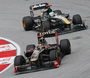 Team Lotus (2010–11) - Nick Heidfeld (Lotus Renault GP) leads Kovalainen (Team Lotus) in the 2011 Malaysian Grand Prix.