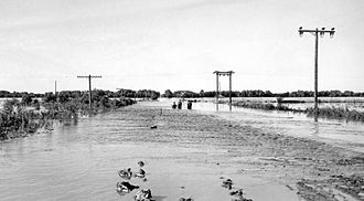 Republic County, Kansas - June 24, 1947 flood of the Republican River on the border of Jewell County, Kansas and Republic County, Kansas near Hardy, Nebraska and Webber, Kansas, just south of Nebraska NE-8 on Kansas 1 Rd/CR-1 bridge over the Republican River. The normal flood stage for the river is at the tree line in the foreground.