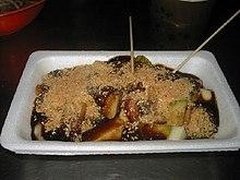 Rojak, a Malaysian salad, in a white styrofoam tray.