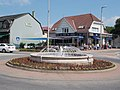Roundabout fountain and Hysteria confectionery in Gyömrő, Pest County, Hungary.jpg
