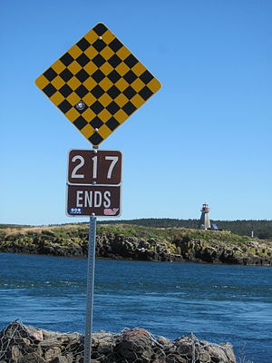 Nova Scotia Route 217 - Western terminus of Route 217 (Water Street) in Westport, Brier Island, with the Peter Island Lighthouse in the background.