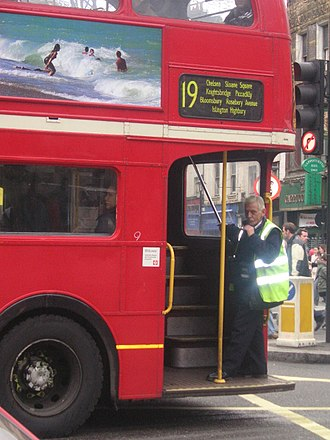 Bus conductor - Traditional British open-platform AEC Routemaster bus, operated with a conductor