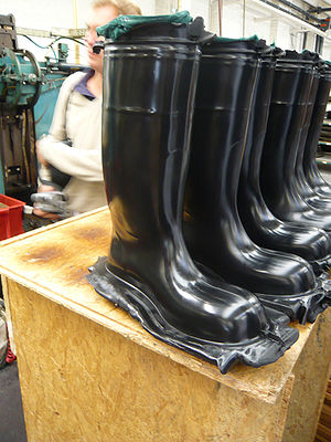Compression molding - Compression molded rubber boots before the flashes are removed.