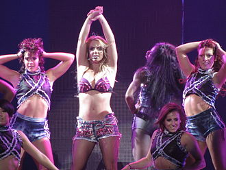 """Britney (album) - Spears performing """"I'm a Slave 4 U"""" on the Femme Fatale Tour in 2011."""