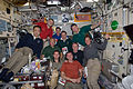 STS-135 and Expedition 28 crews in the Zvezda service module.jpg