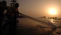 Sailors clean USS Harry S. Truman flight deck DVIDS98827.jpg