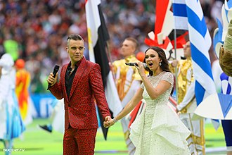 "2018 FIFA World Cup opening ceremony - British singer Robbie Williams and Russian soprano Aida Garifullina performing ""Angels"" at the World Cup opening ceremony."
