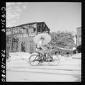 Seaman Paul Gray of San Dimos, Calif., rides Japanese bicycle in Tokyo, Japan. - NARA - 520930.tif