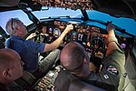 Secretary of the Navy pilots a flight simulator of a P-8A Poseidon aircraft. (36728540721).jpg