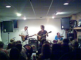 A basement concert, from left to right: Munson, Wilson, and Slichter
