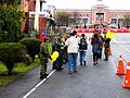 Service Soldiers Giving Event Guide and Memorial Items to Visitors 20130302.jpg