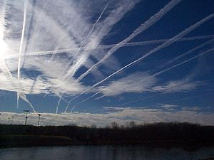 NASA photograph showing aircraft contrails and natural clouds. The temporary disappearance of contrails over North America due to plane groundings after the September 11, 2001 attacks, and the resulting increase in diurnal temperature range gave empirical evidence of the effect of thin ice clouds at the Earth's surface.