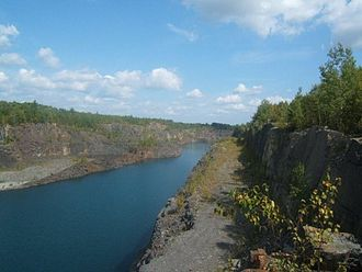 Temagami Greenstone Belt - East Pit of Sherman Mine. This image was taken from a cliff in the middle of the pit