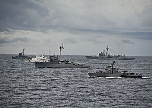 Philippine Coast Guard - Coast Guard patrol boat PCG Pampanga (SARV 003) in formation in the Celebes Sea during joint military exercises with the Philippine Navy with the United States Coast Guard and the U.S. Navy, July 2012