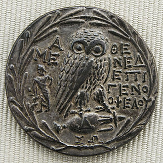 Olive branch - Owl standing on amphora, all surrounded by a wreath of olive leaves. Greek silver tetradrachm from Athens, ca. 200-150 BCE.