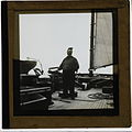 Skipper on board a boat, possibly a ketch, lugger or yawl, early 1900s (2464879559).jpg