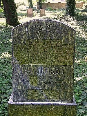Polonization - Gravestone with removed German inscriptions on a cemetery in Gliwice. Also visible is the changing of the name Karl into the Polish Karol