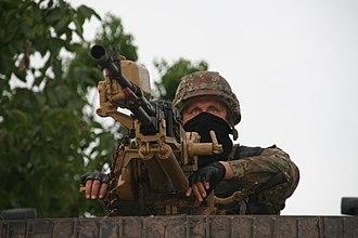 Azov Battalion - A soldier of the Azov Battalion with a heavy machine gun.