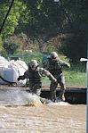 Soldiers must get wet to fight Minot flood 110624-F-WA217-474.jpg