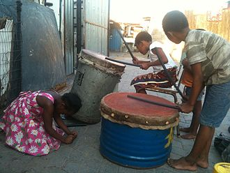Rhythm in Sub-Saharan Africa - Kids in Alexandra township, South Africa, playing around on their father's drums