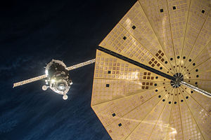 Soyuz TMA-19M - The Soyuz TMA-19M approaches the ISS on 15 December 2015, seen behind the solar panels of Cygnus CRS OA-4