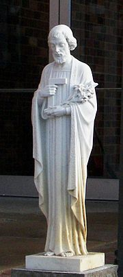 Statue of St. Joseph with a carpenter square symbolizing his trade, and lilies chastity.