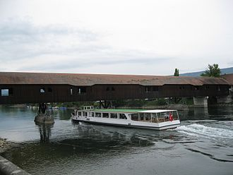 Büren an der Aare - Tour boat Stadt Solothurn passing under the wooden bridge at Büren an der Aare.