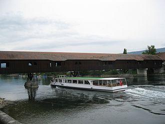 Büren an der Aare - Tour boat Stadt Solothurn passing under the wooden bridge at Büren an der Aare.
