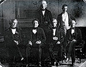 Presidency of James K. Polk - Polk and his cabinet, Front row (left to right): John Y. Mason, William L. Marcy, James K. Polk, Robert J. Walker; Back row (left to right): Cave Johnson, George Bancroft (James Buchanan is absent).