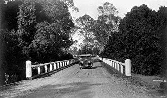 Burpengary, Queensland - Austin motor vehicle crossing a bridge on the North Coast Road at Burpengary, 1934