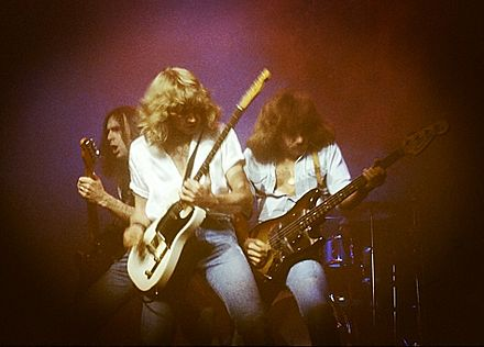 Parfitt (centre), with Status Quo in 1978 Status Quo1978.jpg