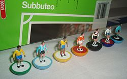 Subbuteo model players with Subbuteo packaging