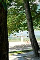 Swimming beach unguarded visitors swimsuit bikini sand Douthat State Park (31393537092).jpg