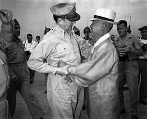 History of South Korea - General Douglas MacArthur and Syngman Rhee, Korea's first President, warmly greet one another upon the General's arrival at Gimpo Air Force Base