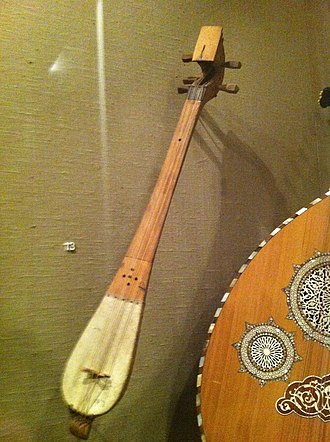 "Qanbūs - A qanbus displayed in the instrument collection of The Metropolitan Museum of Art in New York City. Labeled as ""Syria. 89.4.394""."