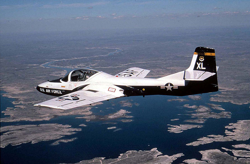 A T-37 Tweet from the 85th Flying Training Squadron, Laughlin Air Force Base, Texas, flies over Amistad Reservoir during a training mission.