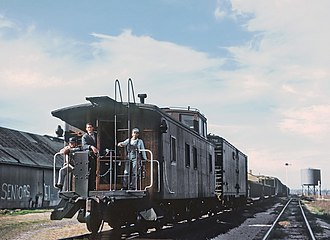 Texas and New Orleans Railroad - Texas and New Orleans RR train crew on a caboose at LaCoste, TX in 1960