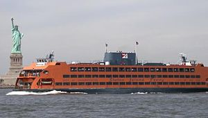 The Andrew J. Barberi passes in front of the Statue of Liberty.JPG