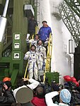 The Expedition 1 crew members pose for final photos prior to their launch.jpg