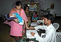 The Polling Officer administering indelible ink at the finger of a voter at a polling station, Chhattisgarh Club, in Chhattisgarh, during General Elections-2009 on April 16, 2009.jpg