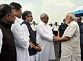 The Prime Minister, Shri Narendra Modi being received by the Chief Minister of Bihar, Shri Nitish Kumar and the Deputy Chief Minister of Bihar, Shri Sushil Modi, on his arrival, at Purnea, Bihar on August 26, 2017.jpg
