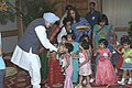 The Prime Minister Dr. Manmohan Singh with the young children who tied Rakhi to him during the auspicious occasion of 'Raksha Bandhan', in New Delhi on August 19, 2005.jpg