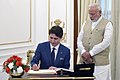 The Prime Minister of Canada, Mr. Justin Trudeau signing the Visitors' Book, at Hyderabad House, in New Delhi on February 23, 2018.jpg