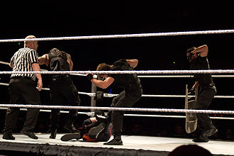 Glossary of professional wrestling terms - The Shield performing a beat down on Kane